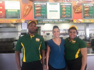 CHI Employment Services Manager Victoria Cani visits with two Nathan's exchange students.